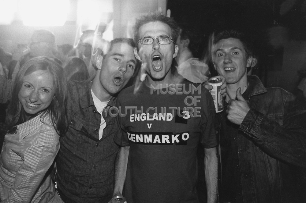 Football fan wearing a T-shirt with 'England 3 v Denmark 0'