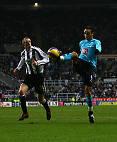 Photo: Andrew Unwin.<br />Newcastle United v Tottenham Hotspur. The Barclays Premiership. 23/12/2006.<br />Tottenham's Dimitar Berbatov (R) looks to control the ball.
