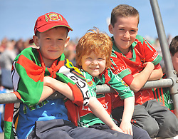 Mayo fans Harry, Andrew and Adam O'Grady from Kilkelly Co. Mayo pictured at the Connacht Championship semi-final against Galway.<br /> Pic Conor McKeown