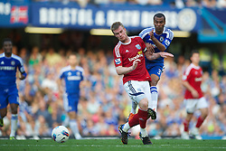 LONDON, ENGLAND - Saturday, August 20, 2011: Chelsea's Ashley Cole in action against West Bromwich Albion's Chris Brunt during the Premiership match at Stamford Bridge. (Pic by David Rawcliffe/Propaganda)
