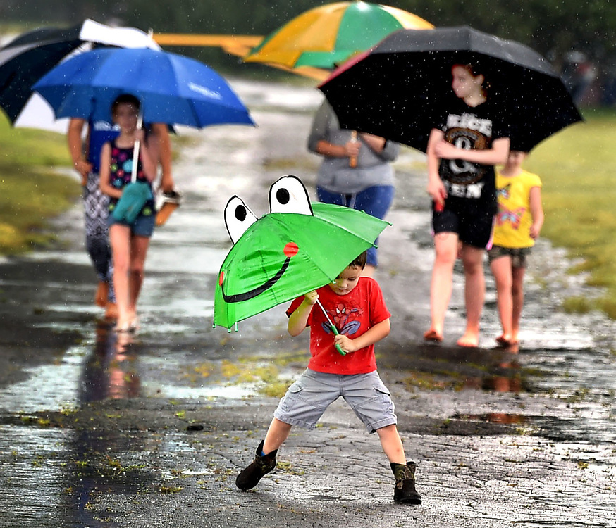 (Mara Lavitt &mdash; New Haven Register) <br /> July 4, 2014 Madison<br /> A wet Independence Day celebrated at Hammonasset Beach State Park. Three-year-old Aiden Dart of Chicopee, MA plays in the puddles as he and his family take a walk to the beach, despite the rain. The extended Dart family camps at Hammonasset several times a year.<br /> mlavitt@newhavenregister.com