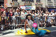 Lashauwn Beyond, of Fort Lauderdale, FL, a finalist in RuPaul's Drag Race and the face of the Greater Fort Lauderdale Convention & Visitors Bureau LGBT campaign, pays homage at the historic Stonewall Inn during the New York Gay Pride Parade to mark the 45th anniversary of the Stonewall Inn riots, Sunday, June 29, 2014.  (Photo by Diane Bondareff/Invision for Greater Fort Lauderdale Convention & Visitors Bureau/AP Images)