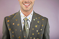 Businessman with gold stars on suit portrait