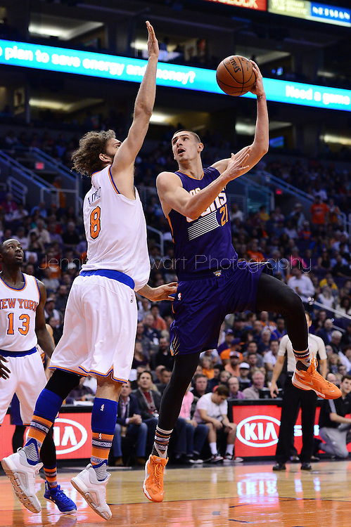 Mar 9, 2016; Phoenix, AZ, USA; Phoenix Suns center Alex Len (21) attempts to lay up the ball against the New York Knicks center Robin Lopez (8) in the first half at Talking Stick Resort Arena. Mandatory Credit: Jennifer Stewart-USA TODAY Sports