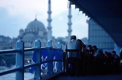 TURKEY ISTANBUL JUL02 - Cafe setup underneath Galatay Bridge, overlooking the Yeni Mosque in Eminönü, downtown Istanbul...jre/Photo by Jiri Rezac..© Jiri Rezac 2002..Contact: +44 (0) 7050 110 417.Mobile:   +44 (0) 7801 337 683.Office:    +44 (0) 20 8968 9635..Email:     jiri@jirirezac.com.Web:     www.jirirezac.com