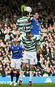 Stephen McManus and Barry Ferguson in aerial action during the League Cup final between Rangers and Celtic at Hampden Park -<br /> David Young Universal News And Sport