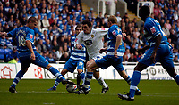Photo: Alan Crowhurst.<br />Reading v Leeds Utd. Coca Cola Championship.<br />29/10/2005. Leeds' Jonathon Douglas (C) tries to go through a sea of blue Reading players.