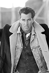 Good looking man wearing layered clothing