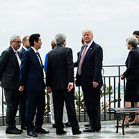 Taormina 26-05-2017 G7, A walk in the G7 leaders before the Summit in the center of Taormina; Jean Claude Juncker, Donald Tusk, Shinzo Abe, Angela Merkel, Paolo Gentiloni, Emmanuel Macron, Donald Trump, Theresa May, Justin Trudeau
