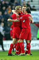Sami Hyypia Celebrates Scoring goal with team mates<br />Liverpool 2005/06<br />Wigan Athletic V Liverpool 11/02/06<br />The Premier League<br />Photo Nick Collins Fotosports International