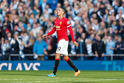 Chris Smalling of Manchester United looks dejected as he leaves the pitch having been shown a is shown a red card by card by referee Michael Oliver - Photo mandatory by-line: Rogan Thomson/JMP - 07966 386802 - 02/11/2014 - SPORT - FOOTBALL - Manchester, England - Etihad Stadium - Manchester City v Manchester United - Barclays Premier League.