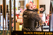Officers clear House of Fraser - Armed police flood the Oxford Circus area after an incident caused the station to be cleared.