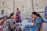Uzbekistan, Bukhara.<br /> Souvenir sellers at the tourist bazaar.
