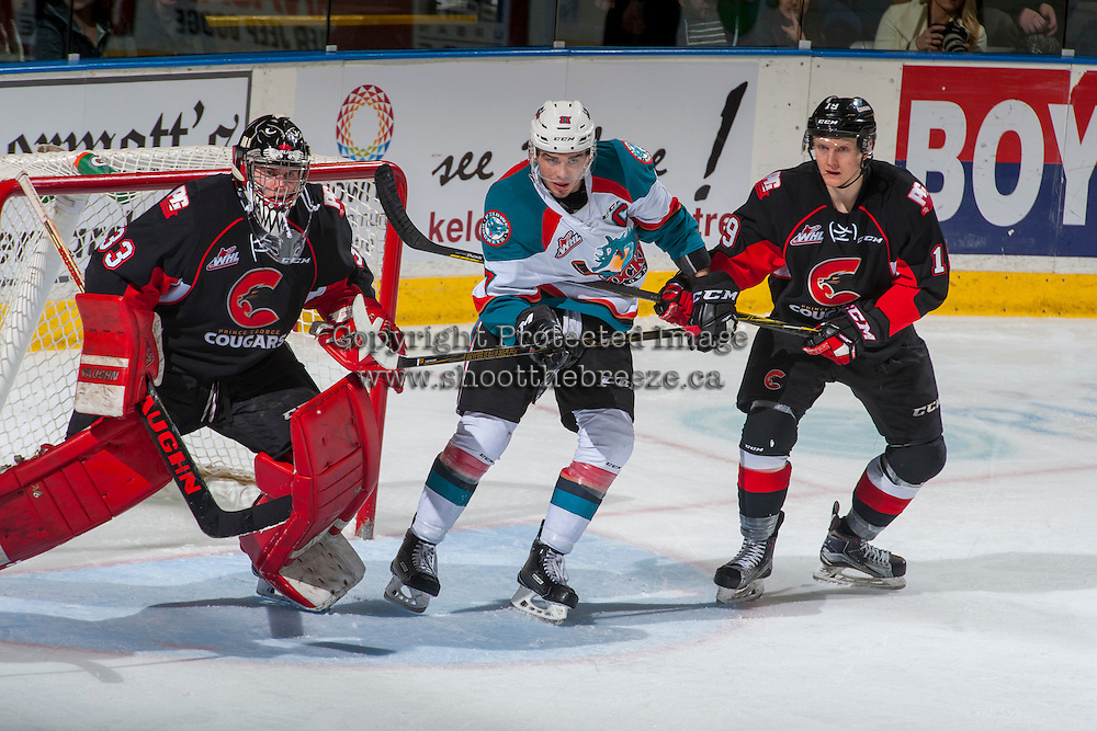 KELOWNA, CANADA - FEBRUARY 18: Nick McBride #33 defends the net as Shane Collins #19 of the Prince George Cougars checks Rodney Southam #17 of the Kelowna Rockets on February 18, 2017 at Prospera Place in Kelowna, British Columbia, Canada.  (Photo by Marissa Baecker/Shoot the Breeze)  *** Local Caption ***
