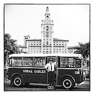 Sam La Roue, with his beautifully restored 1932 Twin Coach bus, originally owned by the City of Coral Gables, in front of the Biltmore Hotel in Coral Gables.