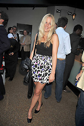 ASTRID HARBORD at the launch party of the new Embargo 59 nightclub at 533 Kings Road, London on 25th June 2009.