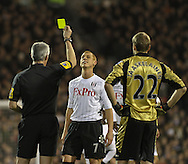 Picture by David Horn/Focus Images Ltd +44 7545 970036.30/01/2013.Steven Sidwell of Fulham receives a yellow card while Jussi Jaaskelainen of West Ham United looks on during the Barclays Premier League match at Craven Cottage, London.