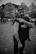 A man showing fascit tattoos before the march. About 2000 fascists gathered in Predappio, Italy to commemorate the annivrsary of the 'Marcia su Roma' A march held on October 28th 1922 and marked the start of the Italian fascist era .Federico Scoppa