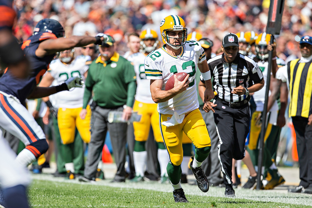 CHICAGO, IL - SEPTEMBER 13:  Aaron Rodgers #12 of the Green Bay Packers runs the ball during a game against the Chicago Bears at Soldier Field on September 13, 2015 in Chicago, Illinois.  The Packers defeated the Bears 31-23.  (Photo by Wesley Hitt/Getty Images) *** Local Caption *** Aaron Rodgers