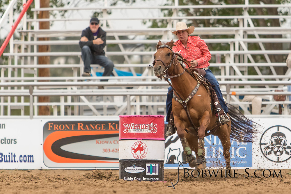 Megan Touros makes her barrel racing run during slack at the Elizabeth Stampede on Sunday, June 3, 2018.