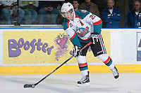 KELOWNA, CANADA - JANUARY 26: Myles Bell #29 of the Kelowna Rockets skates on the ice with the puck against the Prince Albert Raiders at the Kelowna Rockets on January 26, 2013 at Prospera Place in Kelowna, British Columbia, Canada (Photo by Marissa Baecker/Shoot the Breeze) *** Local Caption ***