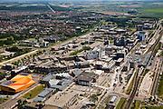 Nederland, Flevoland, Lelystad, 09-04-2008; Stadshart ook wel Lelycentre, overzicht van het centrum van de stad met onder andere het station (met overkapping) en het oranje Agora theater en congrescentrum (architect Ben van Berkel UN-Studio); veel bouwactiviteiten, er wordt gewerkt aan de  revitalisering van het stadscentrum, projectontwikkeling, uitbreiding en nieuwbouw van winkels en woningen;. .luchtfoto (toeslag); aerial photo (additional fee required); .foto Siebe Swart / photo Siebe Swart.