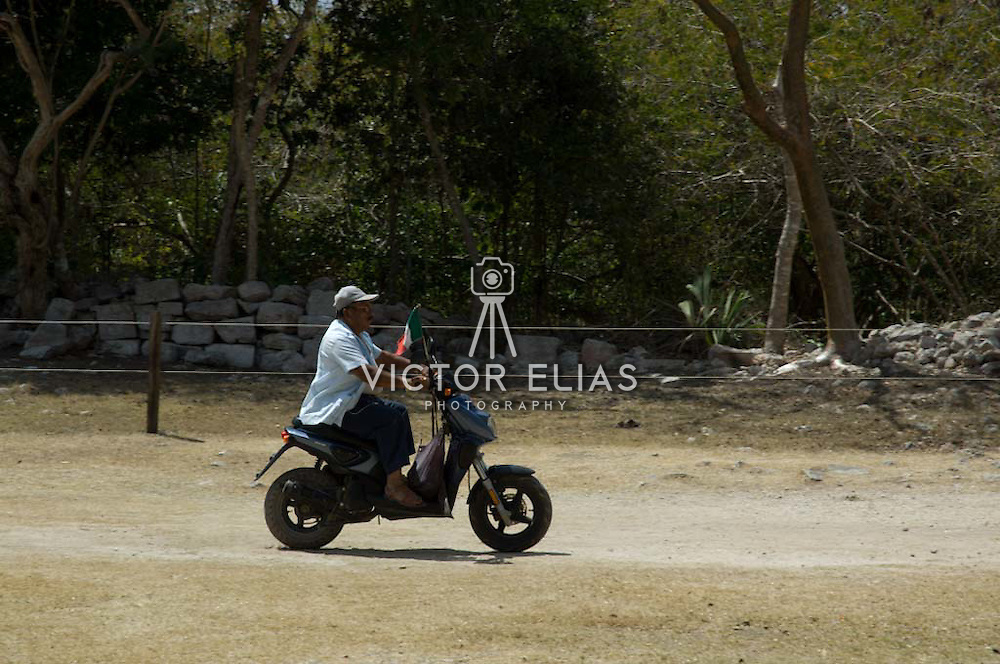 Custodian on motorcicle at Chichen Itza. Yucatan, Mexico.