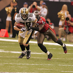 2008 September 7: New Orleans Saints tight end Jeremy Shockey (88) tries to break the tackle on Tampa Bay Buccaneers linebacker Cato June (59) during their game at the Louisiana Superdome in New Orleans, LA.