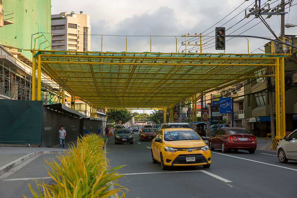 A busy road in downtown Manila with a canopy that protects it from construction in Makati, Metro Manila, Philippines.  (photo by Andrew Aitchison / In pictures via Getty Images)