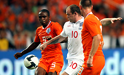 Edson Braafheld (NED), Wayne Rooney (ENG) and Andre Ooller (NED) compete for the ball during the International Friendly between Netherlands and England at the Amsterdam Arena on August 12, 2009 in Amsterdam, Netherlands.