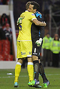 Jos Hooiveld and David Forde celebrate at full time at the Sky Bet Championship match between Nottingham Forest and Millwall at the City Ground, Nottingham, England on 31 January 2015. Photo by Jodie Minter.
