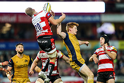 Ross Moriarty of Gloucester Rugby is challenged by Jack Tovey of Bristol Rugby - Rogan Thomson/JMP - 03/12/2016 - RUGBY UNION - Kingsholm Stadium - Gloucester, England - Gloucester Rugby v Bristol Rugby - Aviva Premiership.