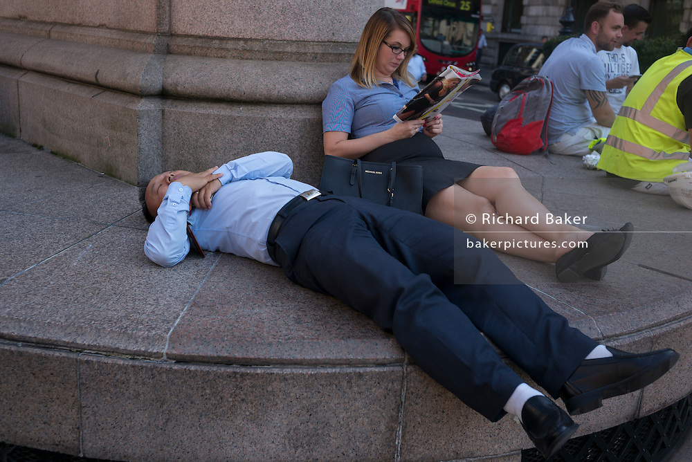 A City worker sleeps outside during an unusual autumn heatwave on 13th September 2016, in the City of London, England.
