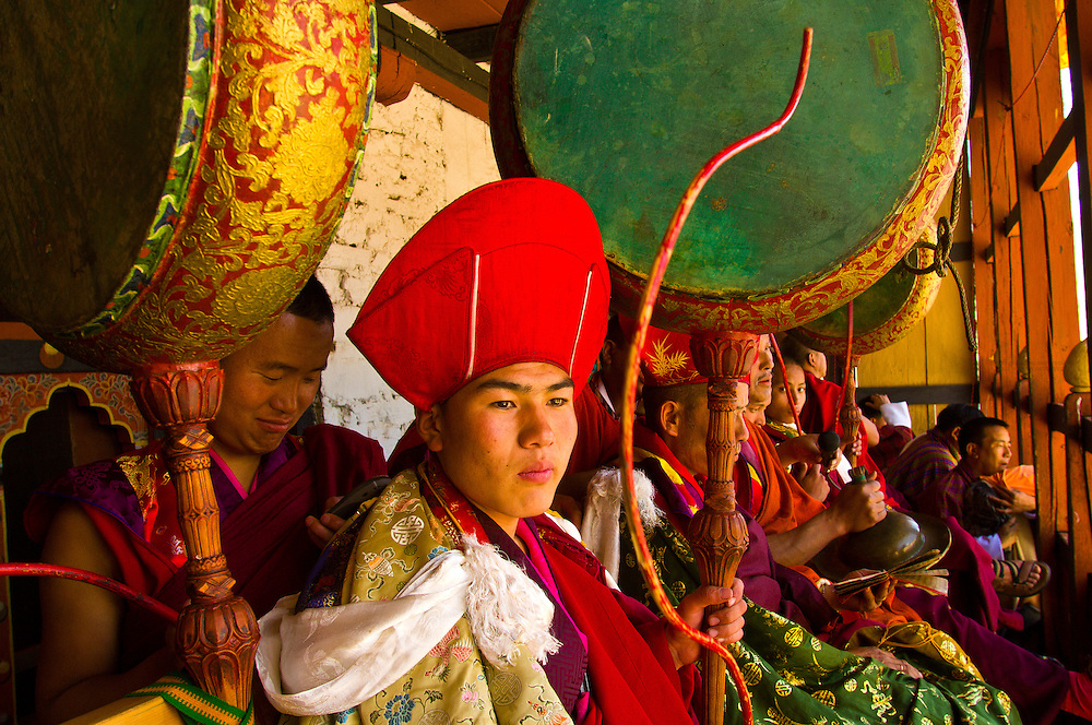 Monks drumming and watching at the Paro Tsechu (Festival), Paro, Bhutan