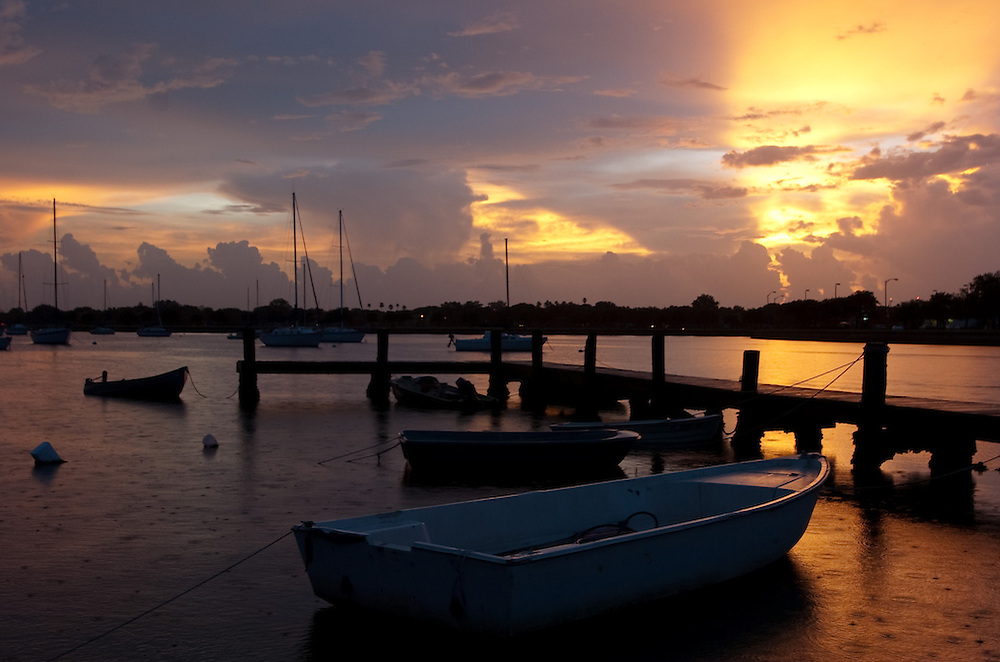The sun sets behind boats moored along Davis Islands Thursday, July 30, 2009 in Tampa.