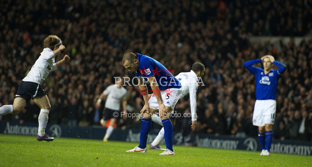 LONDON, ENGLAND - Wednesday, January 11, 2012: Everton's Johh Heitinga reacts following the opening goal during the Premiership match at White Hart Lane. (Pic by Chris Brunskill/Propaganda)