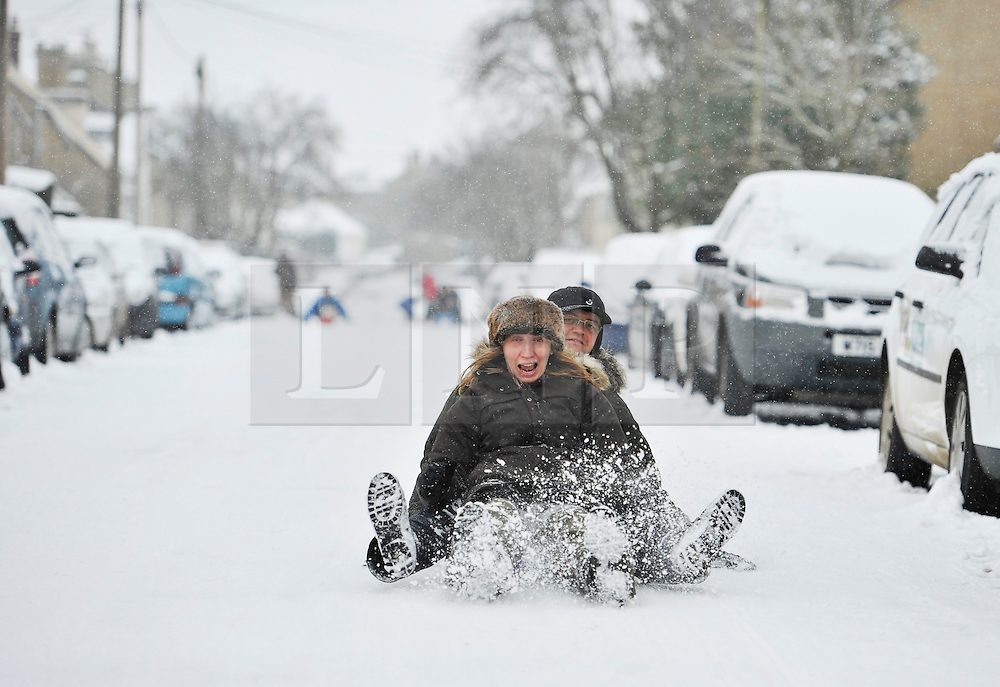© Licensed to London News Pictures. 20 January 2013. Chipping Norton, Oxfordshire. Lorna and Adrian Eaketts-Rogers (42).Probably the best Street in England for sledging? Residents of The Leys in Chipping Norton have made a super sledging run in the road. The local children even prevented council workers from salting the road by sitting down across the road to block the gritters. Everyone who live in the Leys seems to love the sledging run and have even joked that they want to apply for a ski lift to be installed for future years fun.. Photo credit : MarkHemsworth/LNP