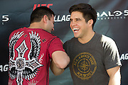 HOUSTON, TX - OCTOBER 3:  Henry Cejudo poses for a photo with a fan during the UFC 192 fan village at the Toyota Center on October 3, 2015 in Houston, Texas. (Photo by Cooper Neill/Zuffa LLC/Zuffa LLC via Getty Images) *** Local Caption *** Henry Cejudo