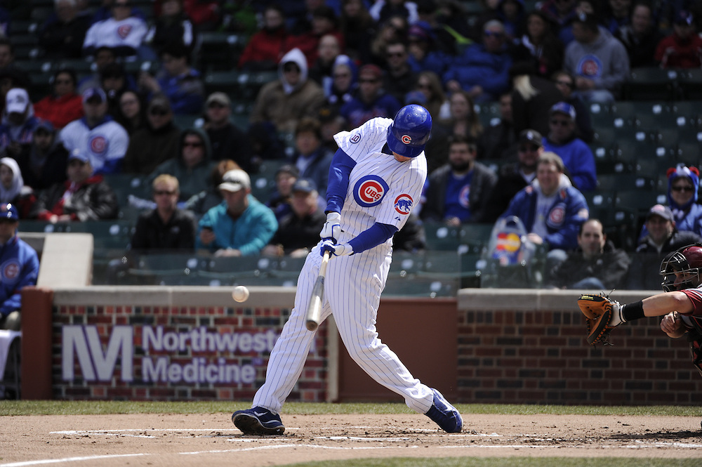 CHICAGO - APRIL  05:  Tyler Colvin #21 of the Chicago Cubs bats against the Arizona Diamondbacks on April 5, 2011 at Wrigley Field in Chicago, Illinois.  The Cubs defeated the Diamondbacks 6-5.  (Photo by Ron Vesely) Subject: Tyler Colvin