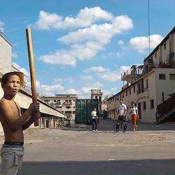 Boys playing baseball in the streets of La Habana, Cuba, Caribbean.