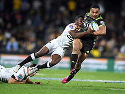 Hurricanes Ngani Laumape, right, tackled by Sharks Lukhanyo Am in the Super Rugby match at McLean Park, Napier, New Zealand, Friday, April 06, 2018. Credit:SNPA / Ross Setford