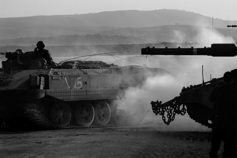 Israeli tanks prepare to cross the border with Lebanon during the Israel Hezbollah war, Aug 2006
