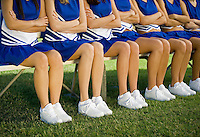 Cheerleaders sitting on bench (low section)