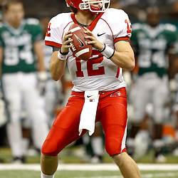 November 10, 2011; New Orleans, LA, USA; Houston Cougars quarterback Cotton Turner (12) looks to throw against the Tulane Green Wave during the second half at the Mercedes-Benz Superdome.  Houston defeated Tulane 73-17. Mandatory Credit: Derick E. Hingle-US PRESSWIRE