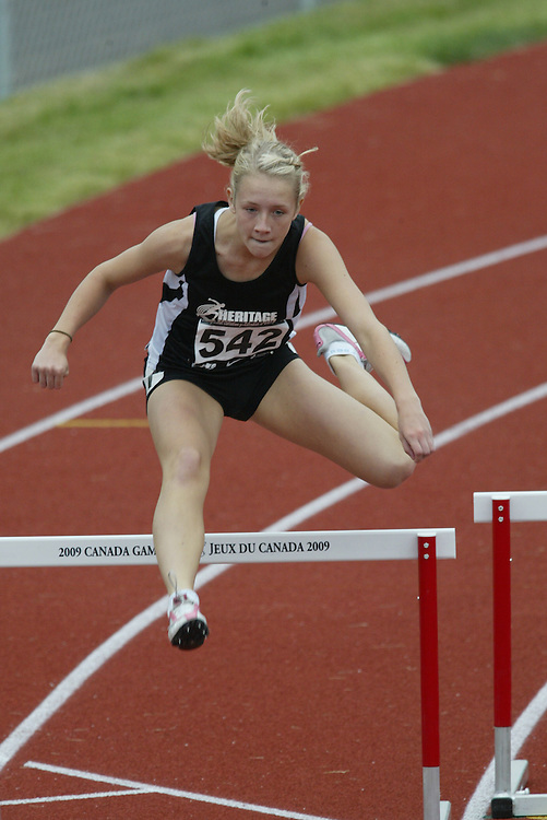 (Charlottetown, Prince Edward Island -- 20090718) Carly Howarth of St-Jean Olympique competes in the 400m hurdles semi-finals,  at the 2009 Canadian Junior Track & Field Championships at UPEI Alumni Canada Games Place on the campus of the University of Prince Edward Island, July 17-19, 2009.  Copyright Sean Burges / Mundo Sport Images , 2009...Mundo Sport Images has been contracted by Athletics Canada to provide images to the media.