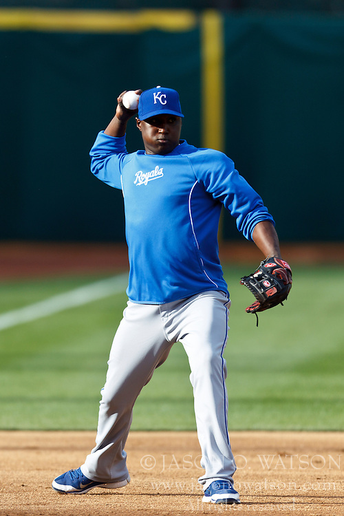 April 9, 2012; Oakland, CA, USA; Kansas City Royals shortstop Yuniesky Betancourt (11) warms up before the game against the Oakland Athletics at O.co Coliseum. Mandatory Credit: Jason O. Watson-US PRESSWIRE
