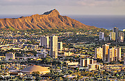 The warm evening light hits Diamond Head crater on Oahu.