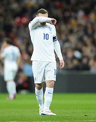 Wayne Rooney of England (Manchester United) mops his brow  - Photo mandatory by-line: Joe Meredith/JMP - Mobile: 07966 386802 - 27/03/2015 - SPORT - Football - London - Wembley Stadium - England v Lithuania - UEFA EURO 2016 Qualifier