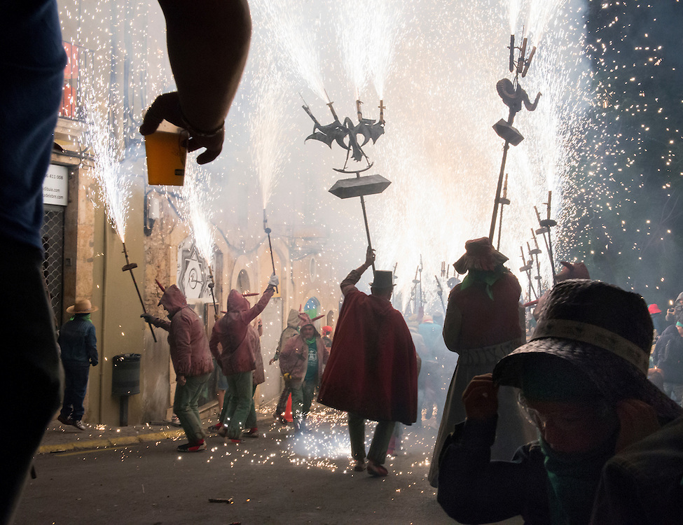 Revelers and dancing devils celebrating during the Ball de Diables. The spectacle took place during Santa Tecla in Tarragona, Spain on September 17, 2013.