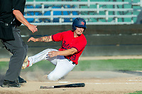 KELOWNA, BC - JULY 17:  Jake Fischer #19 of the Kelowna Falcons slides safe into home plate against the Wenatchee Applesox at Elks Stadium on July 17, 2019 in Kelowna, Canada. (Photo by Marissa Baecker/Shoot the Breeze)